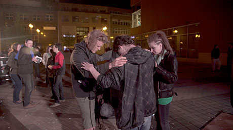 NLM member praying for people after NLM concert in Czech Republic
